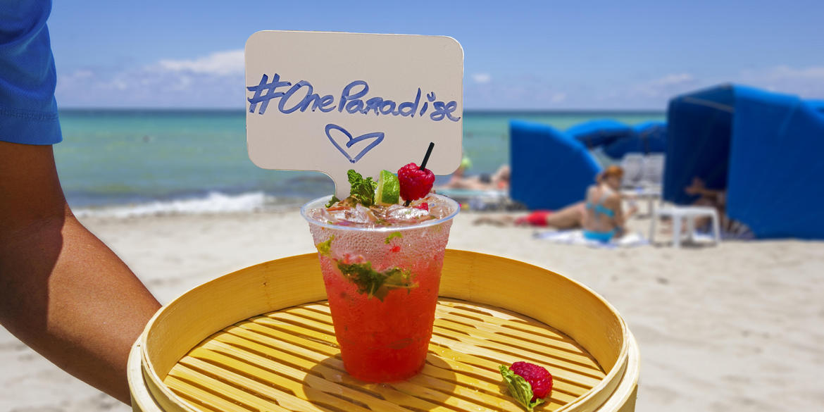 #oneparadise sign in a drink