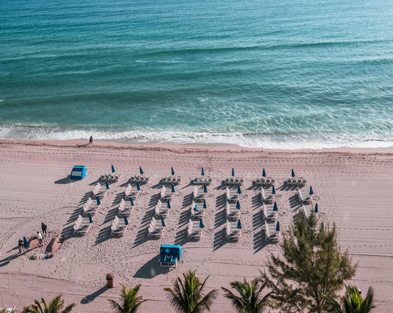 blue loungers and umbrellas on sunny isles beach