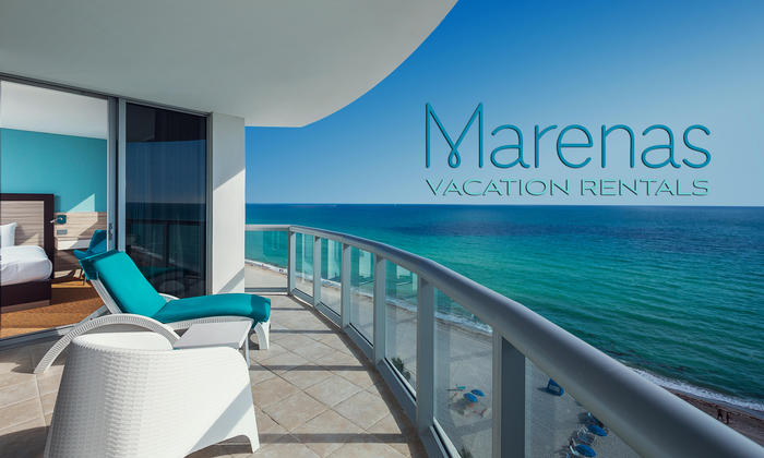 vacation rental lounger on balcony overlooking ocean