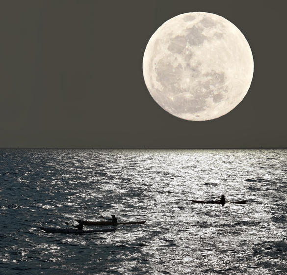 Kayaking with the moon in the sky